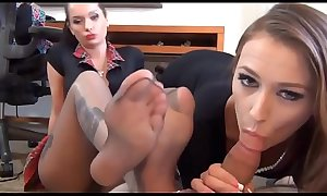 Two brunettes perform double footjob to a guy in POV