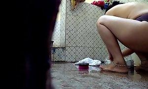 Desi wife captured in bathroom .