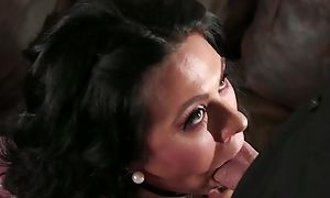 Bearded guy fucks dark-haired housewife in a catch living room